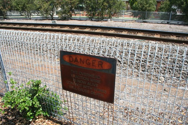'DANGER The overhead traction wire is now alive. Contact with wires will cause death'