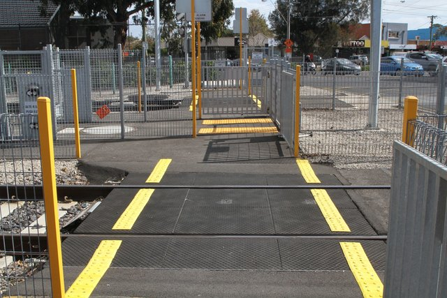 Pair of independent single track pedestrian crossings at the Maidstone Street crossing