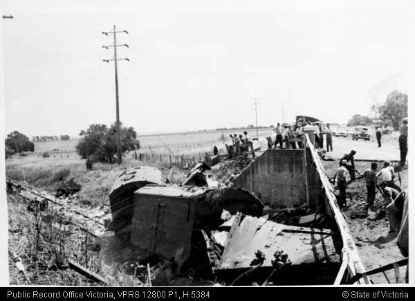 Recovery efforts following a derailed train hitting the bridge in 1959