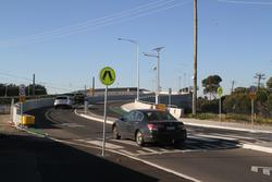 Aviation Road level crossing removal project: Cars drive north over the new Aviation Road bridge