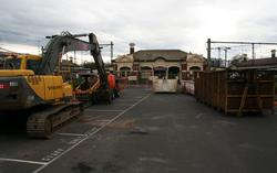 Station building on platform 2/3 surrounded by construction equipment
