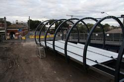 Temporary ramp wraps around the new section of footbridge