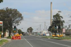 Temporary traffic signals for pedestrians outside the LXRA site office on Kororoit Creek Road