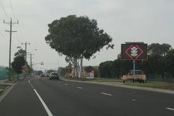 'Traffic lights' message for eastbound motorists approaching the temporary work site pedestrian crossing