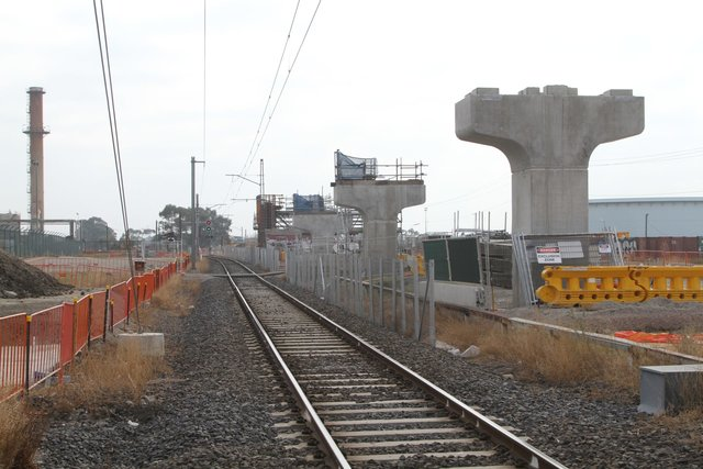 A row of piers in place north-east of the level crossing