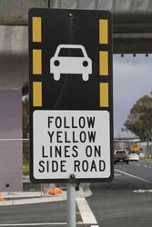 'Follow yellow lines on side road' sign