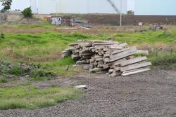 Stockpiled second hand concrete sleepers at Altona Junction