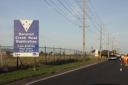 Grade separating Kororoit Creek Road on the Geelong line: Government signage for the road duplication project - $48.5 million