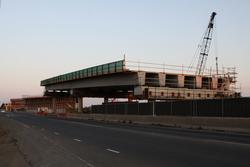 The western approach spans is two lanes across, widening to three lanes at the bottom for a slip lane