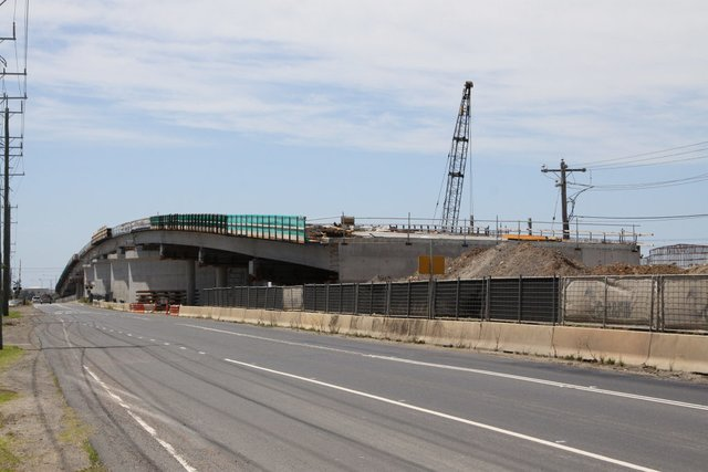 All spans of the westbound bridge complete, approach mound still to be completed