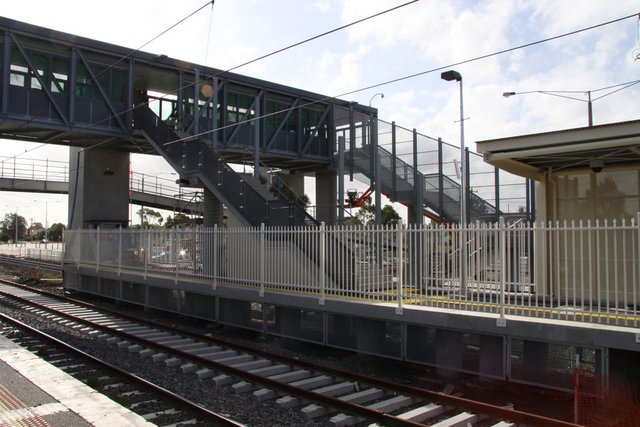Down end of the new platform, dunno how a wheelchair will fit between the stairs and the fence