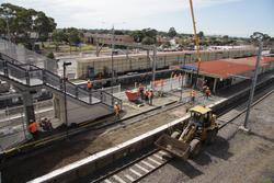 Laverton Rail Upgrade project: Excavator on the track for platform 3, concrete pour continuing