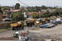 Laverton Rail Upgrade project: Massive dump trucks haul ballast along the road
