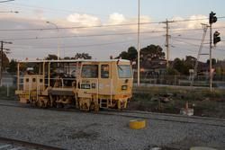 Laverton Rail Upgrade project: Track machine in the track to the 'back' platform, the up signal bagged over for now