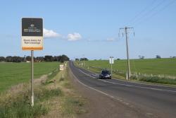 Sign at Geelong-Ballan Road promoting the Kevin Kash spent on the level crossing upgrade
