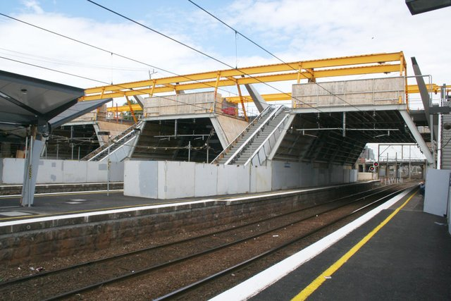 Escalators in place and roof supports underway