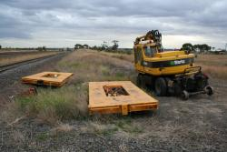 2008 track relaying: Hi-rail excavator with some kind of rail trolleys
