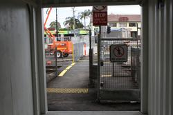 Werribee Street level crossing removal project: ISO containers used to provide a safe pathway for pedestrians through the work site