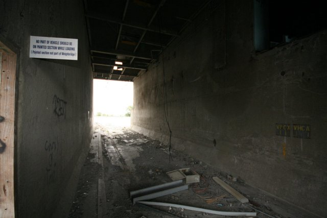 Loading area under the silos,  sign indicating the extent of the weighbridge