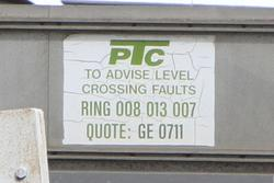 PTC branded level crossing fault sign at GE 0711: Separation Street