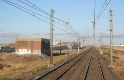 Traction substation at Aircraft, looking down the line
