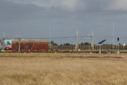 Traction substation at Aircraft, signals for up SG trains approaching Laverton Loop in the foreground