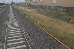 Temporary signal conduit runs beside the tracks between Altona and Williams Landing