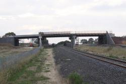 Three span bridge in place over the railway line, looking west