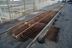 Discharge pit between the rails for the hopper wagons