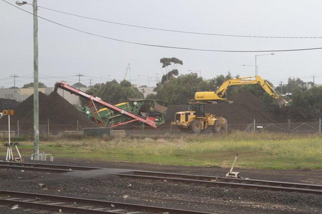 Excavators at work sorting the ballast at the former asphalt plant