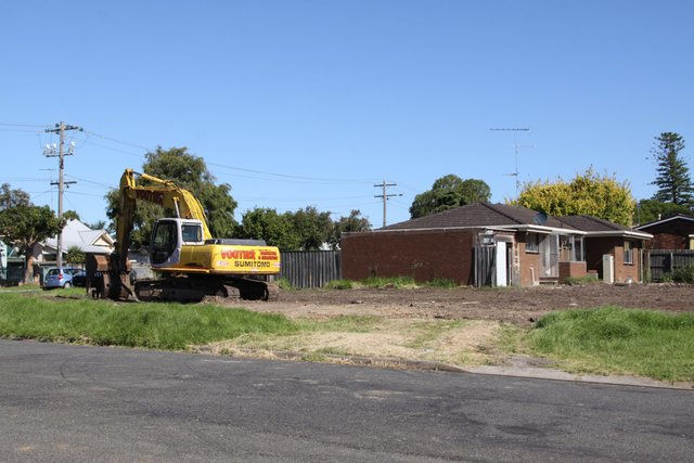 Houses being demolished on Breakwater Road for the new set of traffic lights
