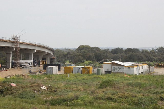 Site huts between the river and the railway