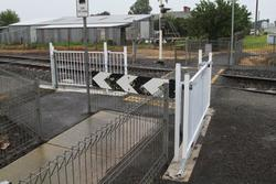 Nonsensical arrangement of movable pedestrian gates at the Church Street level crossing