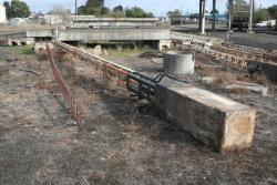 Four removed signal posts in the goods yard