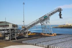 Woodchip loader at Corio Quay North, stacked up aluminium ingots on the wharf