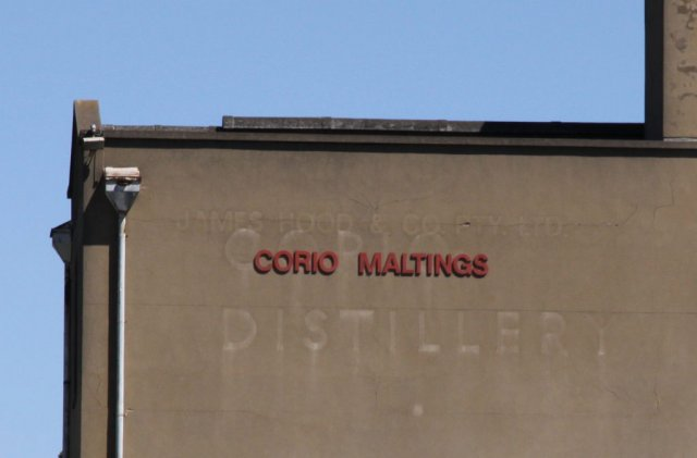 Various layers of signage - 'Corio Maltings', 'Corio DIstillery' and 'James Hood and Co'