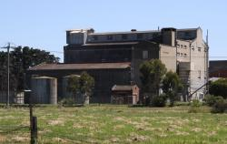Concrete malthouse building from the south
