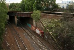 Freight lines pass under the suburban lines at the down end of platform 1/2