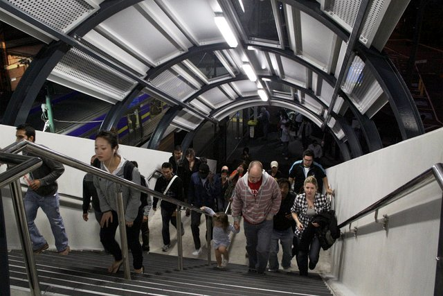 Passengers climb the new stairs from platform 4