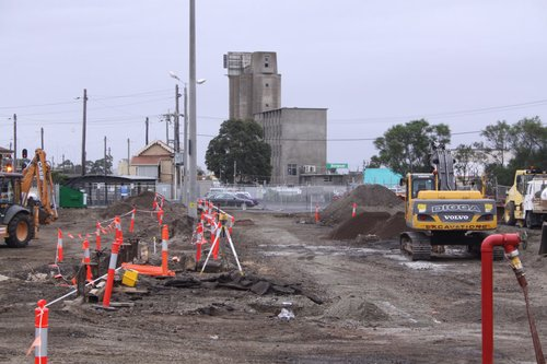 Digging up the car park, remains of the goods platform face now exposed