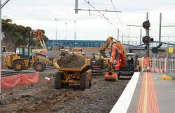 Excavators removing ballast in the platform 1