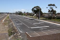 Extended car park along the northern side of the line, all the way to the freeway overpass