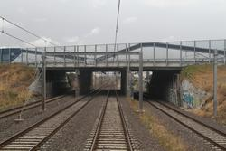 Princes Freeway crosses over the railway at the city end