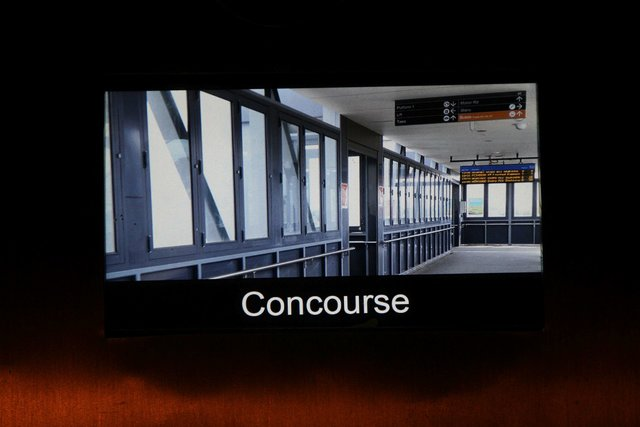 Photo of the Laverton station concourse features on the screen inside the lift