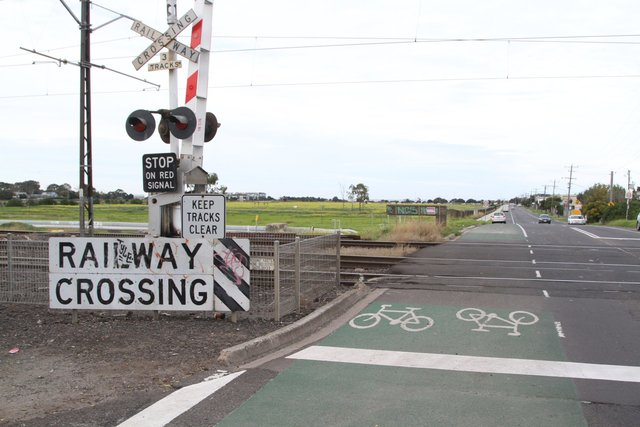 Bidirectional bike lane shares the Maddox Road level crossing