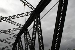 Overhead wires connected to the top of the truss