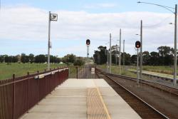 Down end platform extension, the lights at platform level are due to the overhead transmission lines?