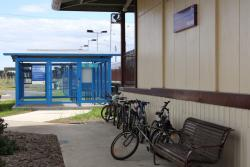 New 'Parkiteer' sitting empty, with a half-dozen bikes chained to the station. The cage was 'opened' back in July 2010