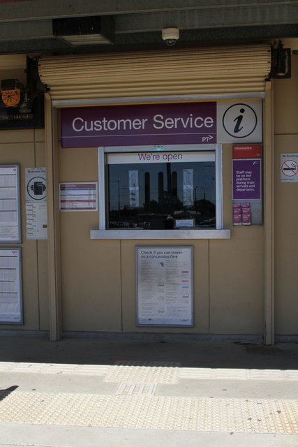Ticket office window, with a 'We're open' sign