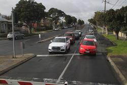 Westbound cars waiting at the McKillop Street level crossing